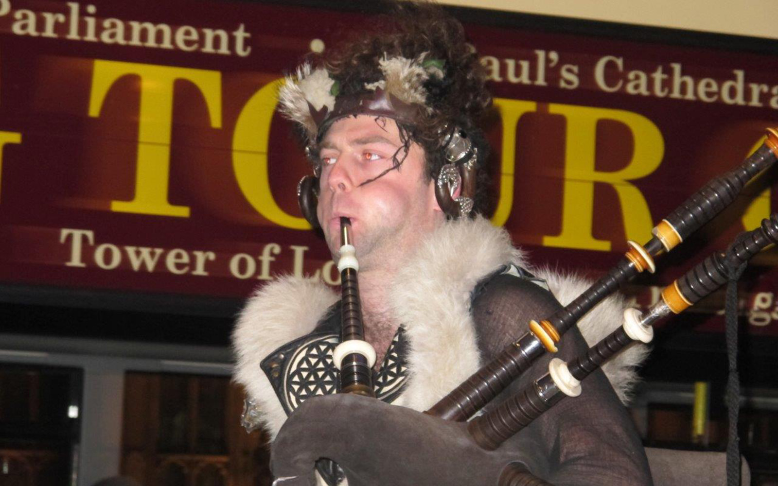 A Man Playing Great Highland Bagpipe